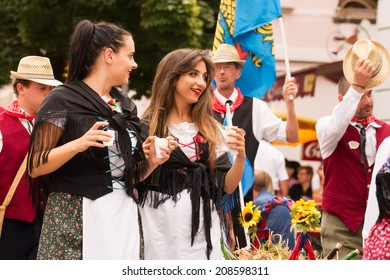 VILLACH, AUSTRIA - AUGUST 2: Lades offering wine at the procession of 'Villacher Kirchtag', the largest traditional folk festival in Austria, August 2, 2014 in Villach, Austria.