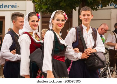 VILLACH, AUSTRIA - AUGUST 2: Participants wearing traditional costumes at the procession of 'Villacher Kirchtag', the largest traditional folk festival in Austria, August 2, 2014 in Villach, Austria.