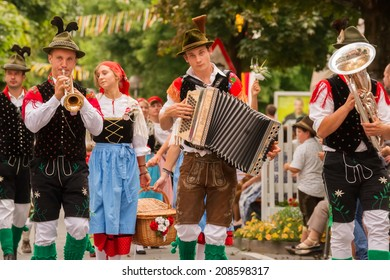 VILLACH, AUSTRIA - AUGUST 2: Young traditional musicians at the procession of 'Villacher Kirchtag', the largest traditional folk festival in Austria, August 2, 2014 in Villach, Austria.