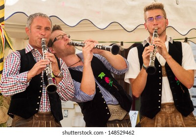 VILLACH, AUSTRIA - AUGUST 3: Traditional folk musicians play for the party in the city at the 'Villacher Kirchtag', the largest traditional folk festival in Austria, August 3, 2013, Villach, Austria.