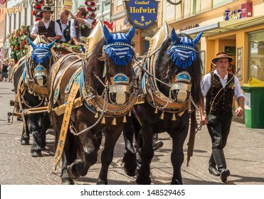VILLACH, AUSTRIA - AUGUST 3: A traditional beerwagon being pulled by a team of horses. Photo taken at the Villacher Kirchtag, the largest folk festival in Austria, August 3, 2013 in Villach, Austria.