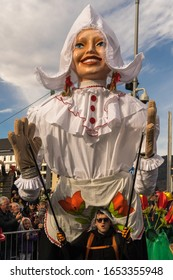 Villach, Austria - February  21st, 2020: A huge puppet walks through the street at the traditional Carnival Procession in Villach.