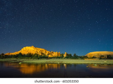 Village of Ait Ben Haddou with starry sky . It is an ighrem (fortified village in English) (ksar in Arabic), along the former caravan route between the Sahara and Marrakech in present-day Morocco.