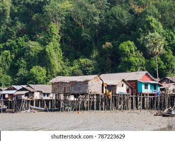 Village along the canal through Kala Island outside Myeik, a part of the Mergui or Myeik Archipelago in the Tanintharyi Region of Southern Myanmar. The photo is taken at low tide.