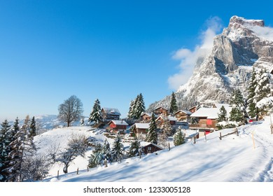 Village in the Alps in the snow. Winter Christmas holidays in Switzerland.