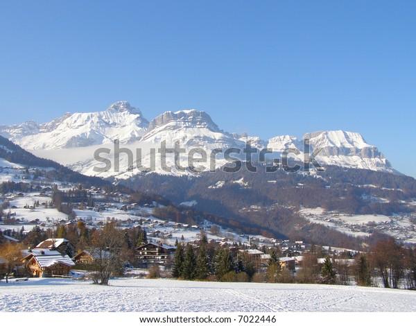 Village and aravis range under snow