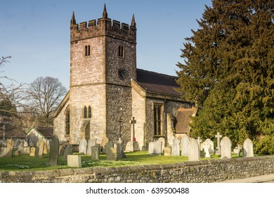 The village of Ashford in the Water, which stands on the river Wye. Part of the present church at Ashford in the Water dates to around 1205, The local congregation is proud of its church.