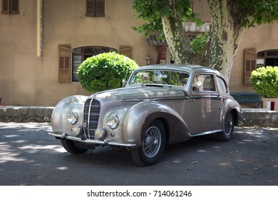 Village of Barjols, FRANCE - JULY 9, 2017 : a beautiful restored 1949 Delahaye Coupe 135 M by Chapron in the street for exhibition