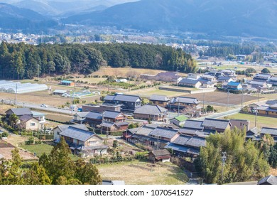 A village between hills nearby a Kanto - Chubu highway in Japan from rooftop view