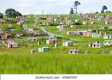 A village of brightly colored Mandela Houses in Zulu Village, Zululand, South Africa