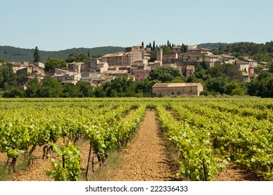 The village of Carces in Provence, France, seen across vineyards.