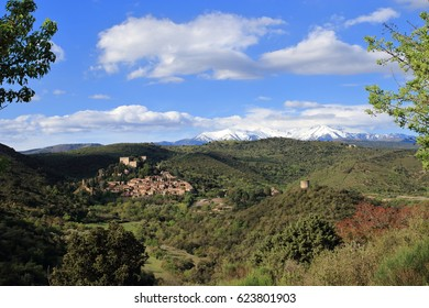Village of Castelnou and peak of Canigou in Pyrenees orientales, South of France