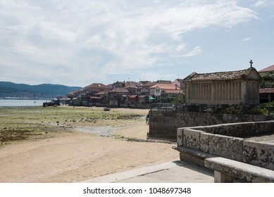 village of Combarro in Ponteveda, Spain, famous for its stone cruceiros (calvaries) and horreos (raised granaries).