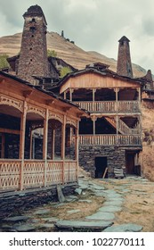 Village Dartlo with traditional stone buildings and defensive towers in Tusheti. Adventure holiday. Travel to Georgia. Ecology tourism. Eco trekking tour. Balcony decorated with fretwork. Vertical