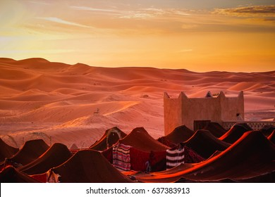 Village in the desert. Nomads in Marocco. desert.Tent houses in desert. Rising Sun in the morning