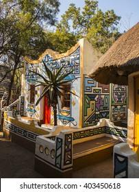 Village in ethnic Ndebele painting style. South Africa. Tribal art. Rondavels - african traditional houses. Modern boho chic.
