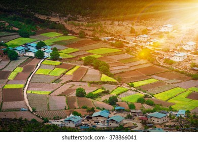 village and fields under the sunshine