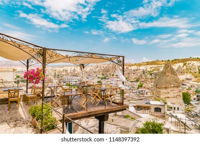 village of Goreme Cappadocia with cave hotels and restaurants at a bright day in summer Kapadokya