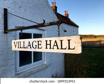A Village Hall sign representing the community meeting place for a small English neighbourhood in the UK
