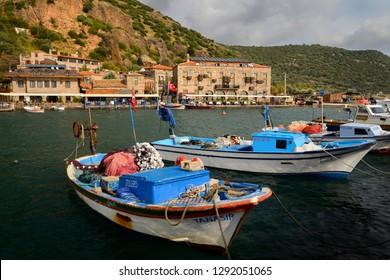 Village hamlet of Assos Iskele or Behram Turkey between sea and cliffs with boats hotels and restaurants Assos (Behramkale), Canakkale, Turkey - November 12, 2012