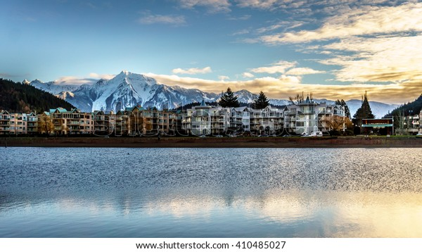 The village of Harrison Hot Springs in the Fraser Valley of British Columbia with the lagoon in the foreground and majestic Mount Cheam in the background