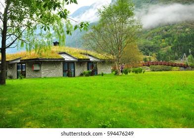 Village house in Gudvangen with slightly hazy mountain in background. Summer in Norway.