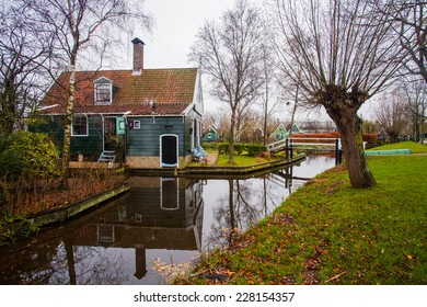 Village house in Holland with a small river and trees