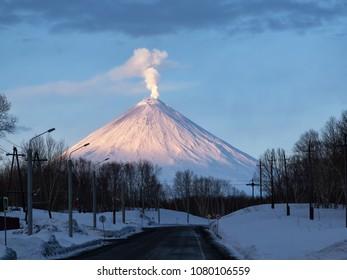 Village Klyuchi. Volcano ashes. Kamchatka Peninsula. Russia - 30 APRIL, 2018:  The volcano of Klyuchevskaya sopka. (4800 m) is the highest active volcano of Eurasia.