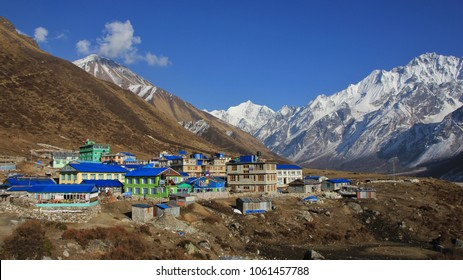 Village Kyanjin Gumba and mountains Tserko Ri, Gangchenpo and Poggen Dopchu. Spring day in the Langtang valley, Nepal.
