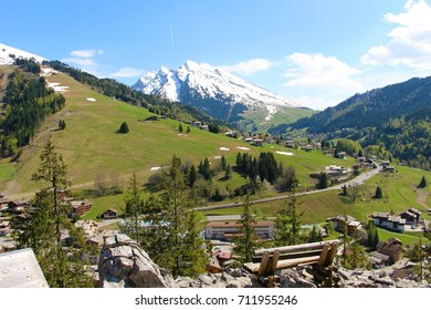 Village of La Clusaz during the summer, in the French Alps. With a snowy mountain in the background