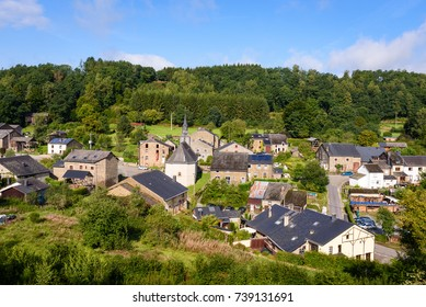 Village Laforet, Ardennes, Belgium. Overview of the small belgian town Laforet with church and typical tobacco barns and tradtional houses near Vresse sur Semois in Ardennes, Wallonia, Belgium.