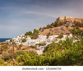 Village of Lindos with fortress on hilltop. Rhodes, Greece.
