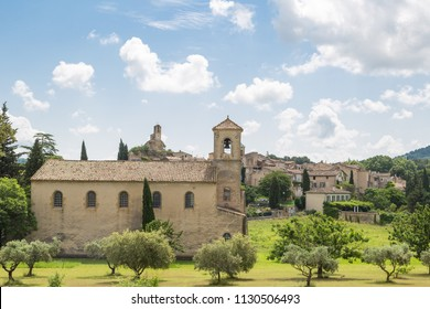 The village of Lourmarin with a small church in front - Provence, France