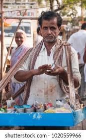 VILLAGE MANJARI, AMRAVATI, MAHARASHTRA, INDIA - 28 MARCH 2016 : Unidentified street vendor selling food and other goods to rural people at weekly market in village.