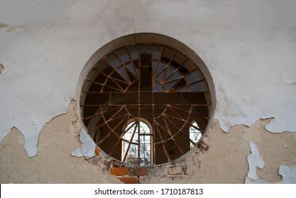 Village motives. Broken round window