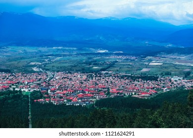 Village in a mountain landscape. Europe, Bulgaria, Bansko. Ski resort city panoramic view.
