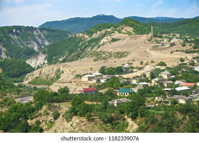 Village in mountains. Clear summer day. Horizontal shot