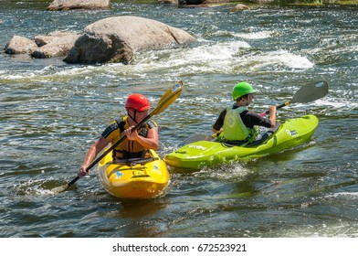 Village Myhiya, Nikolaev region, Ukraine - July 2, 2017: Kayaking on the Southern Bug River in sunny weather. A popular place for extreme recreation and training of rafting and kayaking athletes.