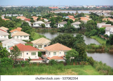 village near small lakes and canal with green environment