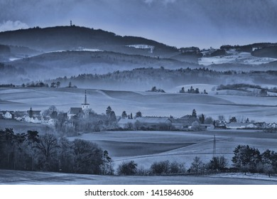 village in the nebulous landscape of the forest of odes after sunset, Germany, Europe