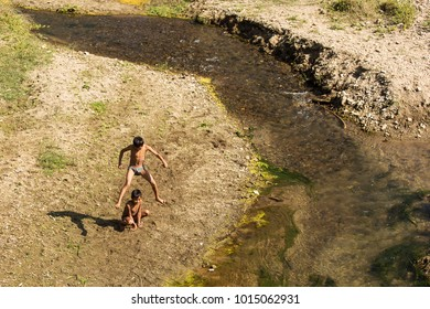 Village, Nepal - November 13, 2017. Children playing near a river in Nepal.