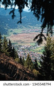 The village of Oberammergau, Bavaria, seen frome a mountain through a natural frame