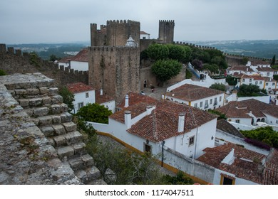 Village of Obidos, district of Leiria, Portugal, May 25, 2017. Town surrounded by the wall of the castle of Obidos, national historical patrimony very visited by tourists.
