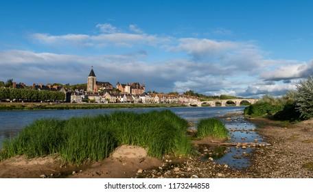 The village og Gien with castle, church and romanesque bridge over the river Loire, Loiret, France.