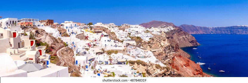 Village of Oia in Santorini,Traditional houses and churches with blue domes- Greece
