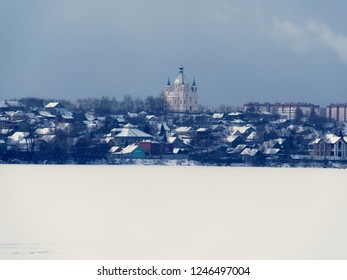 Village with orthodox church in Russia during winter and morning