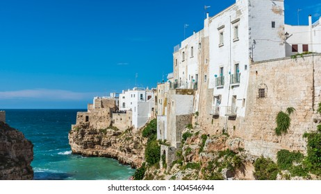 The village of Polignano a Mare overlooking the waves. Colors and atmospheres of Puglia. Italy