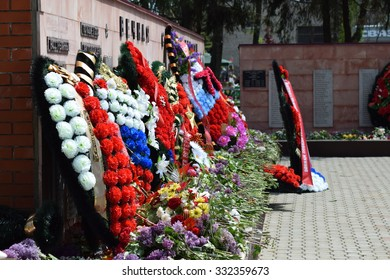 VILLAGE POLTAVA. 9 May, 2015: The laid flowers to a monument in honor of a Victory Day on May 9. Patriotic traditions.