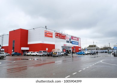 village Poltavskaya, Russia - April 07, 2016: A hypermarket magnet with a large parking near him. Two-storey shopping center.