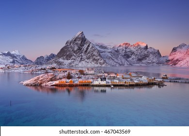 The village of Reine on the Lofoten in northern Norway. Photographed at sunset in winter.